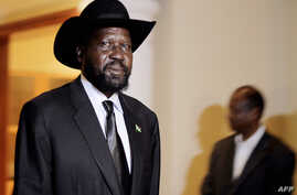 South Sudan's President Salva Kiir walks in a hotel in Addis Ababa, September 24, 2012, where he was to meet with his Sudanese counterpart Omar al-Bashir for a second day of talks.