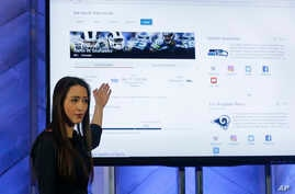 Kristina Behr, partner program manager for AI product design, gives a demonstration of new intelligence search features in Bing at a Microsoft event in San Francisco, California, Dec. 13, 2017.