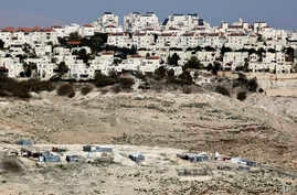 The Israeli settlement of Maaleh Adumim looms over Arab Bedouin shacks in the West Bank, Jan. 22, 2017.