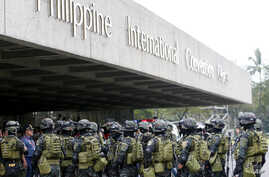 Members of the Philippine National Police Special Action Force conduct a raid to simulate an attack as part of heightened security efforts leading up to next week's APEC (Asia Pacific Economic Cooperation) Summit in Manila, Nov. 14, 2015.