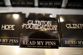 FILE - A Clinton Foundation brooch is seen for sale at the Clinton Museum Store in Little Rock, Arkansas, United States April 27, 2015. The Clinton Foundation's acting chief executive admitted on Sunday that the charity had made mistakes on how it li...