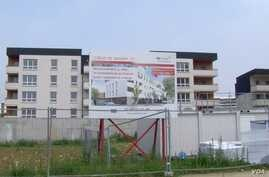 A sign advertises new apartment sales in Grigny, an area of with some of the highest rates of unemployment, school drop outs and illiteracy in France.