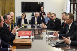 British Secretary of State for International Development Liam Fox, left, and U.S. Trade Representative Ambassador Robert Lighthizer hold the first trade working group in Washington, July 24, 2017.