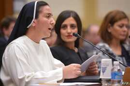 Sister Diana Momeka, a Roman Catholic nun driven out of a convent in Mosul, Iraq, testifies before the House Foreign Affairs Committee during a hearing on IS persecution of religious minorities, on Capitol Hill May 13, 2015.