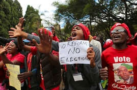 Opposition supporters march on the streets of Harare, Zimbabwe, June, 5, 2018.