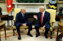 New White House Chief of Staff John Kelly talks with President Donald Trump after being privately sworn in during a ceremony in the Oval Office, July 31, 2017, in Washington.