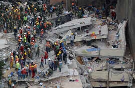 Rescue workers continue to search for people trapped inside a collapsed building in the Del Valle area of Mexico City, Sept. 20, 2017.