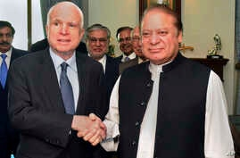 In this photo released by by Pakistan's Press Information Department, visiting U.S. Senator John McCain, left, shakes hand with Pakistani Prime Minister Nawaz Sharif prior to their meeting in Islamabad, July 3, 2017.