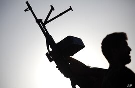 A Free Syrian Army soldier holds a weapon as he takes part in a training session on the outskirts of Idlib, Syria.