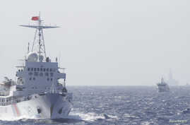Ships of Chinese Coast Guard are seen near Chinese oil rig Haiyang Shi You 981 in the South China Sea, about 210 km (130 miles) off shore of Vietnam, May 14, 2014.