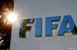 FILE - The logo of FIFA is seen in front of its headquarters in Zurich, Switzerland.