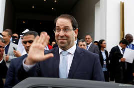 FILE - Tunisia's Prime Minister Youssef Chahed gestures after a meeting of the Islamic Development Bank Group in Tunis, Tunisia, April 4, 2018.