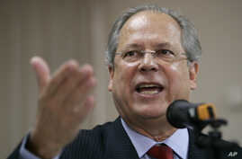 FILE - Former chief of staff Jose Dirceu gestures during a news conference in Sao Paulo, Brazil, Aug. 30, 2007.