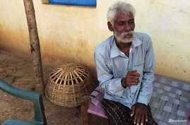 FILE - Rescued bonded laborer Srikrushna Rajhansiya recalls his days in bondage outside his home in Sargul village in the eastern Indian state of Odisha, August 31, 2016.