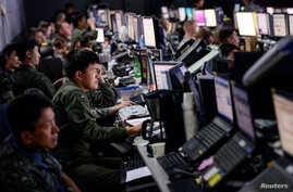 Members of the U.S. and Republic of Korea militaries man the Hardened Theater Air Control Center during the first day of Ulchi Freedom Guardian at Osan Air Base, South Korea, Aug. 17, 2015. The exercise is held annually to strengthen the U.S.-ROK all