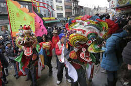 FILE - A pair of lion dancers from the Tai Pun Residents Association perform during a Lunar New Year celebration, in New York's Chinatown neighborhood, Feb. 8, 2016.