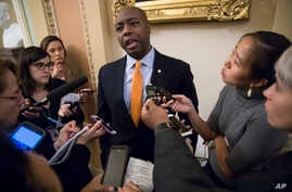 Sen. Tim Scott, R-S.C., talks to reporters about his plan to meet with President Donald Trump to discuss race and Trump's widely criticized response to last month's protests and racial violence in Charlottesville, Virginia, in Washington, Sept. 13, 2...