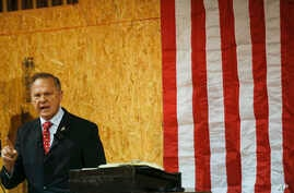 FILE - Former Alabama chief justice and U.S. Senate candidate Roy Moore speaks at a campaign rally, Nov. 30, 2017 in Dora, Alabama.
