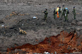 Israeli military personnel search for victims of a collapsed tailings dam owned by Brazilian mining company Vale SA, in Brumadinho, Brazil, Jan. 30, 2019.