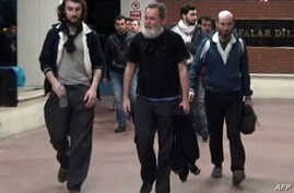 A screengrab taken on April 19, 2014, from a video released by Dogan News Agency shows (from L) Edouard Elias, Didier Francois, Pierre Torres and Nicolas Henin arriving at the Mehmet Akif Inan Training & Research Hospital at Sanliurfa, near the Syria