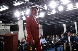 House Minority Leader Nancy Pelosi leaves a news conference at the Capitol in Washington, Nov. 15, 2018. Her bid to return as House speaker is putting newly-elected Democrats in a spot.