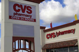 (File)  CVS Caremark says it will stop selling all tobacco products by October 1.