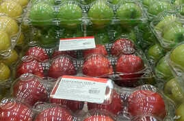 FILE - Apples imported from the United States are displayed for sale at a Sam's Club in Mexico City, May 31, 2018.