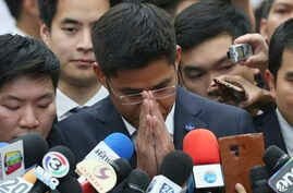 Leader of Thai Raksa Chart party Preechapol Pongpanich, center, gestures as he talks to media at the Constitutional Court in Bangkok, Thailand, Thursday, March 7, 2019.