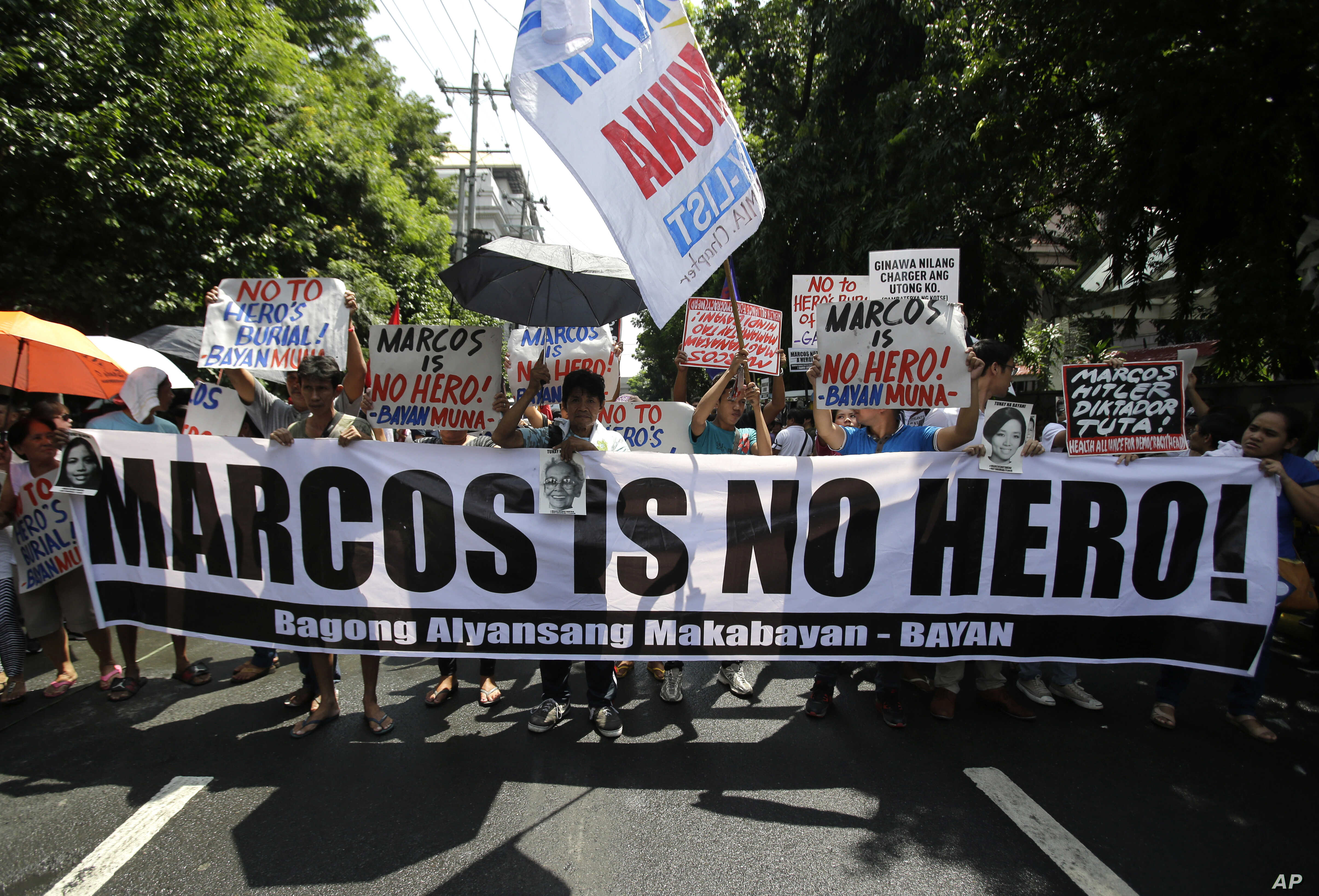 Philippines Marcos Burial: Anti-Marcos protesters holds slogans in a rally outside the Philippine Supreme Court in Manila, Philippines to coincide with the oral arguments following petitions filed by various civil society groups opposing the hero's b