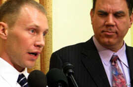 U.S. Army Specialist Mathew Justice (l) and Florida Representative Alan Grayson