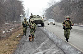Interior Ministry officers patrol a motorway from the town of Malgobek to Nazran in the Russian southern region of Ingushetia, January 28, 2011.
