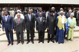 Heads of state and members of the Economic Community Of West African States (ECOWAS) pose for a photograph after attending the 39th ECOWAS Summit in Nigeria's capital Abuja March 23, 2011.