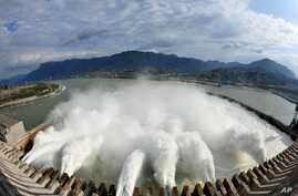 In this photo released by China's Xinhua News Agency, flow of water is discharged through the Three Gorges Dam in Yichang City, central China's Hubei Province, Nov. 7, 2008.