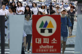 A sign for a bomb shelter is seen at an entrance of a subway station in Seoul, South Korea, Aug. 11, 2017.
