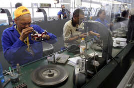 FILE - Diamonds are polished at the Krochmal and Cohen diamond factory in Johannesburg.