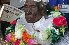 Rebecca Kadi Loburang Dinduch, believed to be the oldest south Sudanese, leaves a polling station after casting her vote in Juba January 12, 2011. Said to be 115 years old, Dinduch said the referendum period was the best time in south Sudan's history