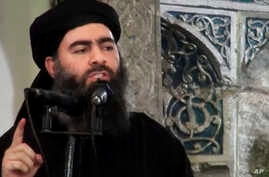 FILE - This image made from video posted on a militant website July 5, 2014, purports to show the leader of the Islamic State group, Abu Bakr al-Baghdadi, delivering a sermon at a mosque in Iraq during his first public appearance.