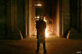 Russian artist Pyotr Pavlensky poses after setting fire to the doors of the headquarters of the FSB security service, the successor to the KGB, in central Moscow, Nov. 9, 2015.