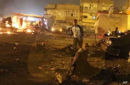 This grab taken from Al-Hadath Channel video on Jan. 23, 2018, shows debris at the site of a deadly explosion in Benghazi, Libya.