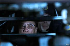 FILE - In this Feb. 20, 2017 photo, Donald Tsang, former leader of Hong Kong, is escorted in a prison bus leaving the high court after sentencing and mitigation after his conviction for misconduct in public office, in Hong Kong.