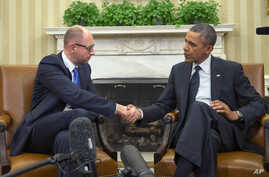 President Barack Obama, right, and Ukraine Prime Minister Arseniy Yatsenyuk, left, shake hands in the Oval Office of the White House in Washington, March 12, 2014