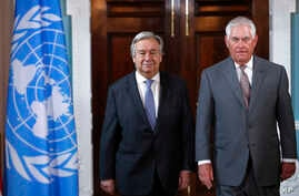 Secretary of State Rex Tillerson, right, walks with U.N.