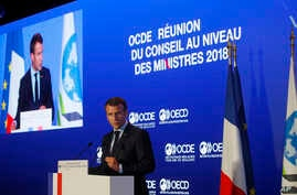 """French President Emmanuel Macron delivers a speech at the OECD ministerial council meeting on """"Refounding Multilateralism"""" in Paris, May 30, 2018. Macron warned against trade wars in an impassioned speech about international cooperation Wednesday, tw"""