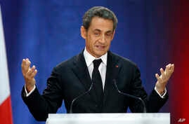 FILE- In this Sept. 25, 2014 file photo, former French President, Nicolas Sarkozy, speaks as part of his campaign for the leadership of his conservative UMP party in Lambersart, northern France.