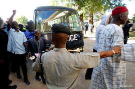 FILE - Gambian political prisoners arrive at the Supreme Court for trial in Banjul, Gambia, Dec. 5, 2016.
