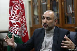 In this Oct. 24, 2015, photo, Afghan National Security Adviser Mohammad Hanif Atmar speaks with The Associated Press, in Kabul, Afghanistan.