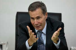 FILE - Alberto Nisman, the prosecutor investigating the 1994 bombing of the Argentine-Israeli Mutual Association community center, talks to journalists in Buenos Aires, Argentina, May 29, 2013.