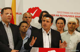 Macedonian Social Democratic leader Zoran Zaev (center) and members of his party attend a news conference in Skopje, Macedonia, April 28, 2017, a day after protesters attacked parliament.