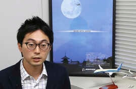 "In this Sept. 4, 2018, photo, Fumiaki Ebihara, the flying-car chief at the Ministry of Economy, Trade and Industry, speaks during a interview with the Associated Press in Tokyo, Tuesday, Sept. 4, 2018. The Japanese government has started a ""flying ca"