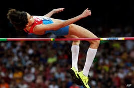 FILE - Russia's Anna Chicherova competes in the women's high jump final at the World Athletics Championships at the Bird's Nest stadium in Beijing, Aug. 29, 2015.